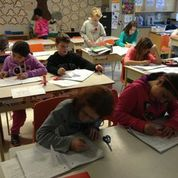 students working on math journals - part of the grade 4-5-6 math inquiry